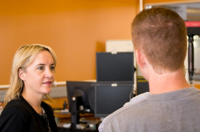 Photo of Nikki Kay in conversation with PhD student Tom Allen